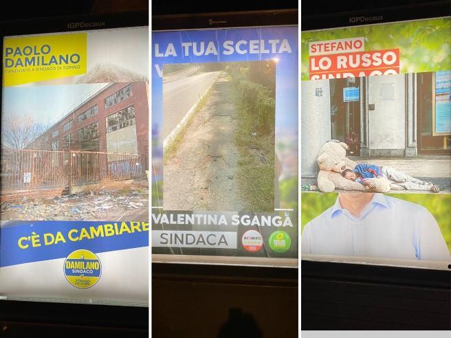 Il Banksy torinese «oscura» i candidati sindaco con le foto del degrado cittadino